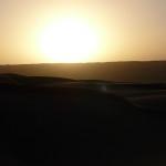 Omán - západ slunce v poušti Wahiba